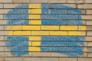 2157240-flag-of-sweden-on-grunge-brick-wall-painted-with-chalk